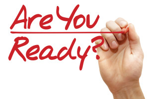 Hand writing Are You Ready with red marker, business concept